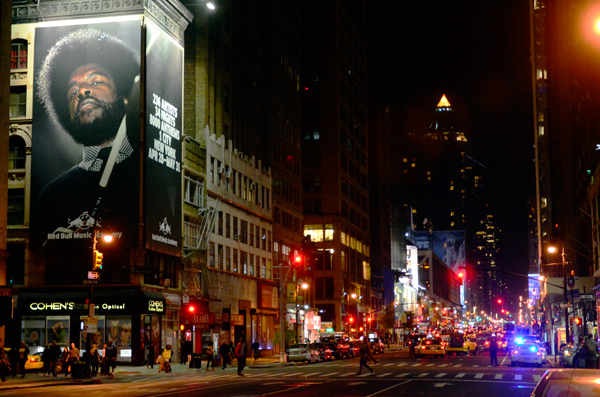 """Questlove"" looking down on Eighth Ave"